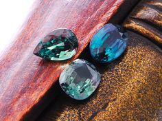 Natural alexandrires are beautiful just as they are.  Indian, African and Brazilan alexandrites side by side.