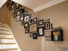 Picture frames on staircase wall: I love this look; unified though with a lot of variation in frame types, some of the items on the wall aren't even pictures. Picture frames on staircase wall: Stairway Photos, Stairway Gallery, Gallery Walls, Stairwell Pictures, Stairwell Wall, Stairway Walls, Framed Pictures, Wall Photos, Photos Encadrées