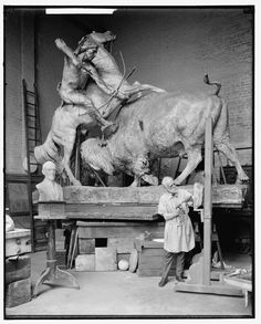 Museum sculpture. Bison about to gore a horse carrying Indian about to shoot the bison with a bow and arrow.