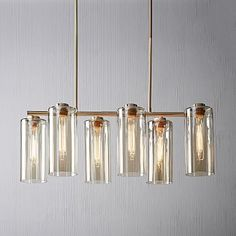 Shop glass cylinder chandelier from west elm. Find a wide selection of furniture and decor options that will suit your tastes, including a variety of glass cylinder chandelier. West Elm Chandelier, Mobile Chandelier, Mid Century Chandelier, 3 Light Chandelier, Sputnik Chandelier, Rectangle Chandelier, Chandeliers, Chandelier Ideas, Kitchen Chandelier