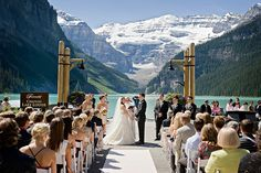 Lakeside wedding ceremony at Lake Louise with the glacier in the background.