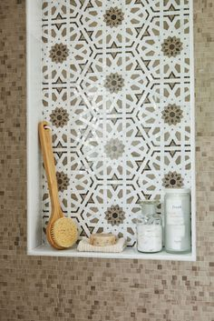 Shower with Style!  A shower niche is a great place to add decorative flair to your bathroom.  This beautiful composition feautres the Granada Pattern from our Villa d'Oro Collection. Granada recalls the intricate detail of Moroccan architecture, but also has a modern feel. Each piece of mosaic tile is hand cut to create this amazing pattern.  Get more inspiration at our website: walkerzanger.com.