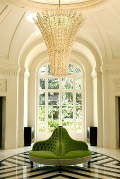 Green Settee and awesome chandelier