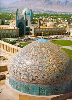The dome of the Sheikh Lotfollah mosque is seen across the Shah Mosque at Naghshejahan square in Isfahan, Iran