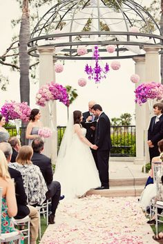 A fluorescent chandelier and vivid pink flowers - Lily Stein for Jim Kennedy Photographers