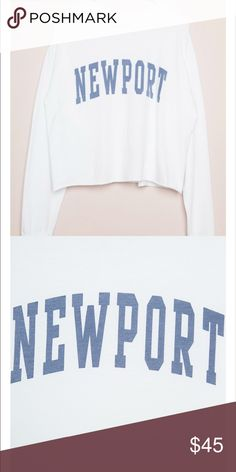 NWT brandy Newport long sleeve crop OS raw hem Cotton white long sleeve top with faded blue Newport print across the chest and raw edge trimming on the waist.  Fabrics: 100% cotton Brandy Melville Tops