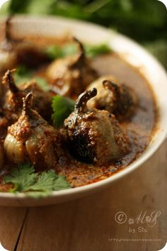 Stuffed baby eggplants in peanut and coconut gravy   Recipe~ http://www.monsoonspice.com/2012/05/simple-quick-stuffed-baby.html