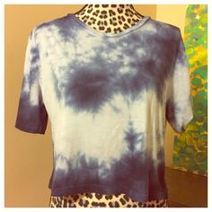 """John Galt - Brandy Melville Tie Dye Crop Top - OS John Galt - Brandy Melville Tie Dye Crop Top - OS --- bust is 20"""" --- length 19.5"""" --- Shades Of Blue Tie Dye  --- Extremely soft -- 60% cotton ---  40% modal---  very good used condition---  please feel free to ask me any questions --- thank you for shopping my closet  Brandy Melville Tops Crop Tops"""