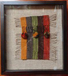 Textil a telar sobre arpillera, marco madera con cubierta de vidro. 41 cms x 37 cms