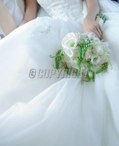 Beautiful white bridal bouquet with large space for your text on wedding dress
