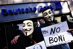 """Protesters of Cologne's 'Anonymous' group wear Guy Fawkes masks made popular by the graphic novel """"V for Vendetta"""" as they demonstrate against banking and finance in front of a branch of Germany's largest bank 'Deutsche Bank' in Cologne October 15, 2011. Protesters worldwide geared up for a cry of rage on Saturday against bankers, financiers and politicians they accuse of ruining global economies and condemning millions to poverty and hardship through greed."""