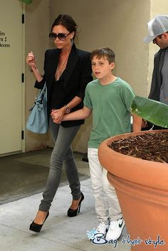 Victoria Beckham totes her tots and a Birkin – obviously