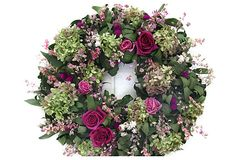 "18"" Pink Roses & Larkspur Wreath Hydrangeas and roses, welcome harbingers of spring, add a lovely, feminine touch to a door or wall. The lush wreath also features pink larkspur, amaranth, and fragrant oregano.  From The Garden specializes in beautiful, modern designs of dried and preserved floral wreaths and arrangements.  Made of: salal, freeze-dried roses, pee gee hydrangea, larkspur, globe amaranth, ammobium, oregano."