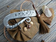 Hand Forged viking fire striker, firesteel and flint set in leather pouch