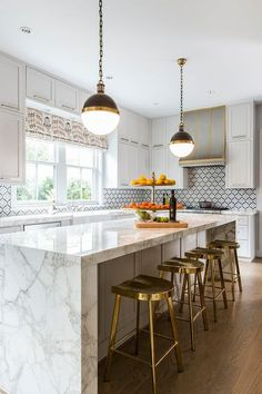 Hicks Pendant lights over a white and gray marble waterfall island in a transiti. - Hicks Pendant lights over a white and gray marble waterfall island in a transitional kitchen showca - Marble Floor Kitchen, White Marble Kitchen, White Kitchen Island, Gold Kitchen, Kitchen Island With Seating, Wooden Kitchen, Kitchen Flooring, New Kitchen, Gray Marble