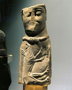 Male deity pillar statue with collar and carved wild boar on chest, in limestone, from Euffigneix. Celtic civilization, France, 1st century b.C.