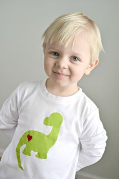From heart tees with sweet appliqués to handmade screen printed shirts, here are nine sweet Valentine's Day styles for the love of your life. Diy Valentine's Shirts, Diy Shirt, Kids Shirts, Tee Shirts, Valentines For Boys, Valentines Day Shirts, Sewing For Kids, Baby Sewing, Custom T Shirt Printing