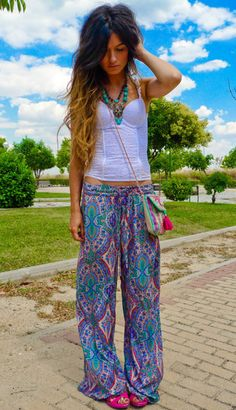 Palazzo pants are perfect combination of comfort and style for back to school! This pair features a mixed paisley floral print, trendy wide leg, and an over sized waist band. 95% Polyester 5% Spandex