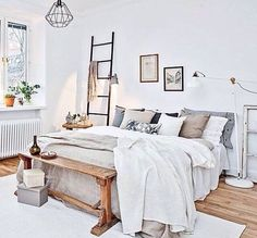 Beautiful bedroom decoration with a bed, cushions & colorful pillows & a white rug on the wooden floor, a wall canvas gallery as well as other elegance accessories. It's a modern and classic bed room decoration idea. www.urbanroad.com...
