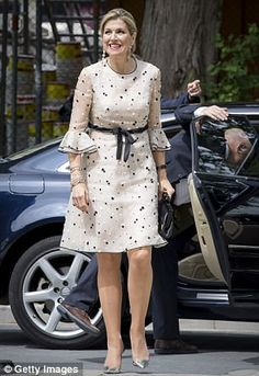 Queen Maxima looked to be enjoying the Spring sunshine as she strode towards a cancer research centre in the city
