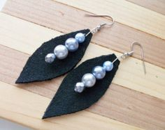 Black leather and pearl leaf earrings -