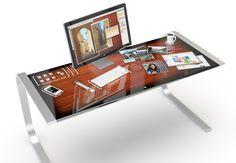 #Escritorio. Mesa con un toque #futurista que simplificaría todas nuestras tareas diarias. Se integra perfectamente con los programas del Mac, aplicaciones del iPhone, el ratón del ordenador y hasta una taza con un café que no dañaría la superficie.