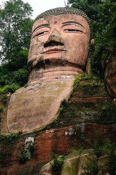 Giant Buddha, Leshan, China * Arielle Gabriel writes of her financial disaster and prayers as a Buddhist in The Goddess of Mercy & The Dept of Miracles, a book of disasters and miracles, as a mystic in a world of moneyminded Hong Kong ex-pats *