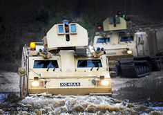 A Royal Marine Viking All Terrain Vehicle negotiates a deep water ditch on Bovington ranges, as part of a joint Royal Marine and Army training package.