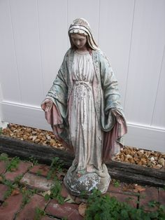 exterior want.  this is the mary statue that used to live in my backyard, but the previous owners took her before we moved in, after i fell in love with her.  i'd love to find another with the same kind of colored, but aged feel.