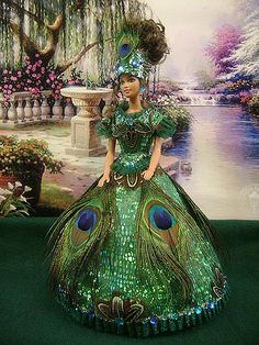 """https://flic.kr/p/5DpvtB   Barbie """"Lady Peacock""""   Barbie Doll """"Lady Peacock"""" is part of my own collection. I designed and created outfit and hairstyle by myself. All outfits are handmade. I didn't use a sawing machine. Every doll is my baby, becase I put part of my heart in it. To see more dolls from my collection please visit www.barbiebackintime.com"""