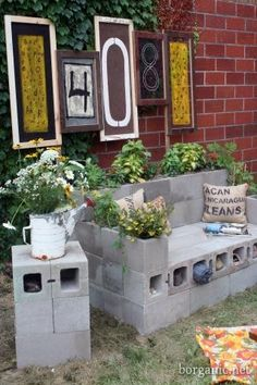 """Cinderblock Garden Furniture- Throw some cushions on that """"couch"""", plant your favorite flowers and herbs, and you're all set!"""