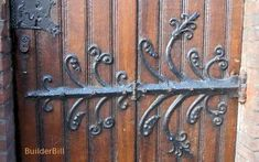 Wrought iron door hinges on a door in Bruges, Belgium