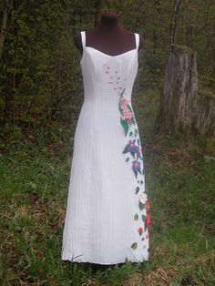 I'm planning on getting a simple, eco friendly dress or a used one and adding embellishments like this. From Tara Lynn Bridal.