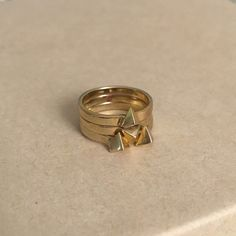 PM Editor Pick Gorjana Pyramid Stacking Ring Set Gold plated. Set of 3 rings. Love this boho modern style. Great to mix and match with other jewelry. Great condition. Very slight tarnishing. Gorjana Jewelry Rings