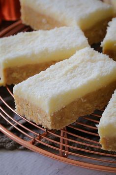 This new and improved Lemon & Coconut Slice recipe is absolutely perfect! A beautiful tangy base topped with a creamy lemon frosting... it seriously doesn't get any better than this!    #lemon #coconut #slice #bars #nobake #recipe #best #easy #thermomix #conventional #lunchbox #classic