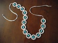 Ever wondered what to do with thos plastic rings around the milk jug and water bottles - make jewelry  or even a belt like this woman did!  Pretty cool way to reuse something we thought was waste!