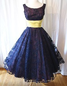 Navy lace dress and yellow sash