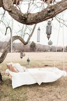 floating bed and hanging lanterns lounge area - photo by Lauren Fair Photography