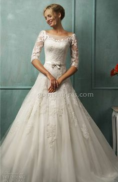 Lace wedding dress.  Loose the bow and add a blinged out sash!