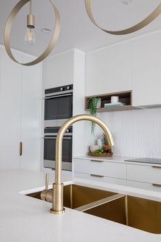 This typical brick home in Mansfield, Brisbane has been given a complete transformation thanks to building company Zou Build . We chat to Zou Build's design and colour consultant Christal Fysentzou on this remarkable renovation. Home Renovation, Home Remodeling, Gold Taps, Greenhouse Interiors, Colour Consultant, Deco Design, House And Home Magazine, Hanging Rail, Eclectic Decor