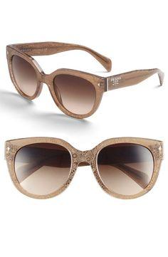 Prada Sunglasses.