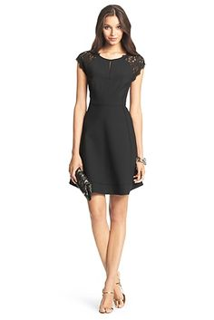 This is a black DVF cocktail dress with small/thin key hole, lace cap sleeves, and lace on the top back of the dress with a key hole. I love this dress! It is prefect for a holiday party or an cocktail party.