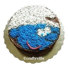 Make a cute smurfy cake! How to make an easy smurf cake idea with blue colored sugar and mini marshmallows. Also find smurf cake pans, smurf cake...