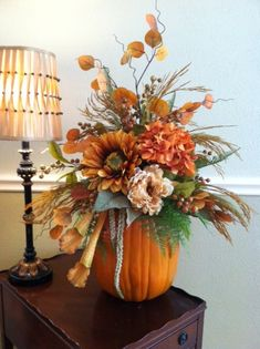 Faux Pumpkin with Silk Flowers by Greatwood Floral Designs.