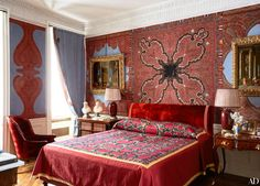 inspired ~ The master bedroom walls are swathed in antique Kashmiri shawls sewn onto a powder blue fabric, the same treatment used for the curtains; the bedspread is made with an antique suzani