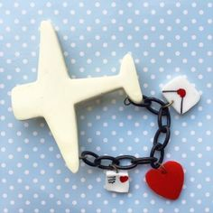 This Aeroplane pin by Mrs Polly's Lucite is a lovely reproduction of patriotic styles.