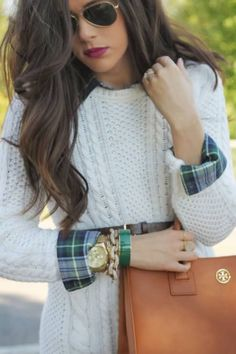 Plaid button up underneath a cable knit sweater paired with a Tory Burch bag.