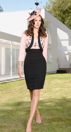 Condici 70780B.Available in sizes 8-24.This is a classic Condici dress and jacket.The dress features a beautiful soft layered look with contrasting pink embellished bust and a matching pink and black bolero.