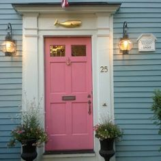 A blue beach cottage with a pink door and an anchor door knocker. Perfection!