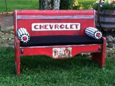 Bed to Bench Transformation--LOVE THE EMBELLISHMENTS--license plate, chains, lights and car title--it really looks like an old rusty pickup!